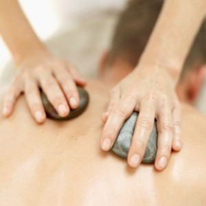 woman massages man with Hot Stones in Redding