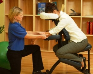 office worker receives chair massage