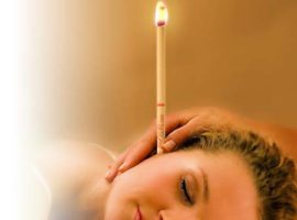 ear candling a woman's ears